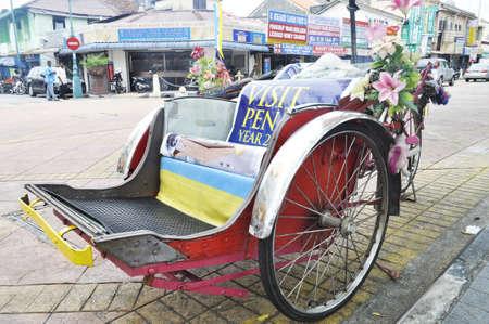 trishaw: Trishaw parking beside a lane