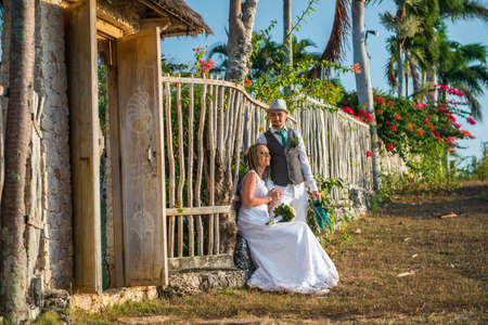 wedding bride: couple near the wooden fence in the light of the sun Stock Photo