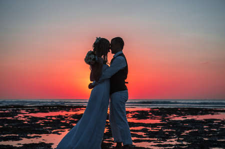 relationship love: Honeymoon silhouette at sunset on the ocean