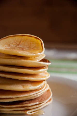 spoonful: fragrant pancakes for breakfast with a spoonful of honey flavored Stock Photo