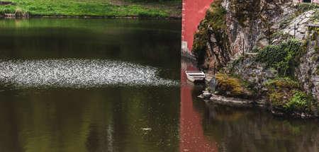 draw bridge: little boat on a lake near the castle