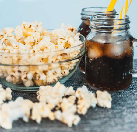 misted: misted bottles of Cola with ice and fresh kettle corn Stock Photo