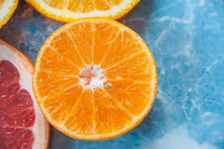 mixed wallpaper: grapefruit, orange and tangerine on blue background. Citrus texture
