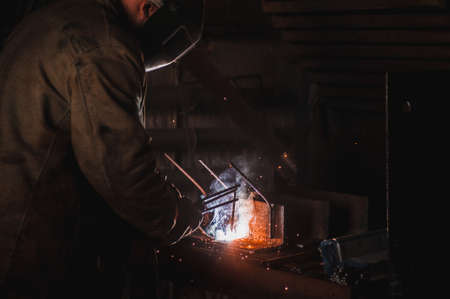 sparklet: The job of a welder. A large concrete products plant and welding on it.