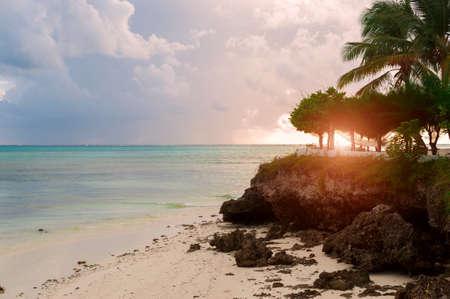 Dawn over the Indian ocean. Sun and sky in the tropics. The Island Of Zanzibar, Tanzania. Фото со стока