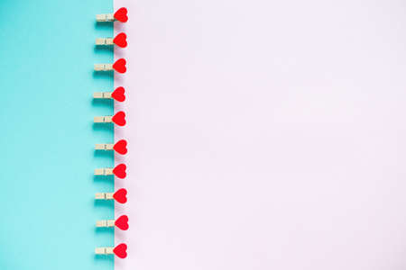 Hearts on pastel blue and pink background. Valentines day concept. Flat lay, top view, copy space. Valentine's Day background.