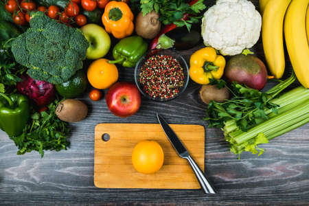 Harvest Festival, Thanksgiving. Diet for weight loss. A balanced healthy diet. Useful recipes. Eco-, bio-products. Cooking smoothies. On a cutting board is knife and orange. Flatlay, layout, view top.