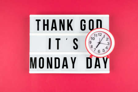 Lightbox on a red background, text Thank you God its Monday day and alarm clock.
