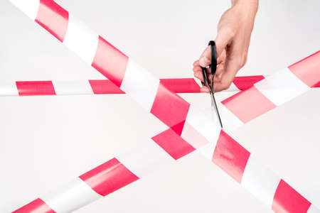 Red-white restrictive tape on white