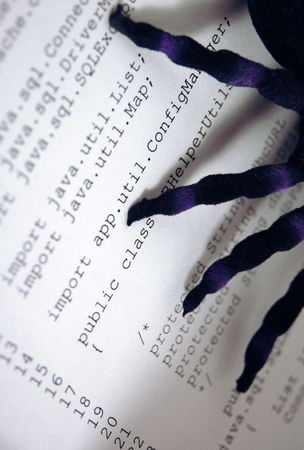 Image of spider on hardcopy of computer code. Indicates bugs or errors or problems with computer programs or software. Shadows from spider legs indicate infection or infiltration into program.