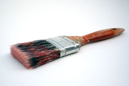 bristles: Grungy well-used paintbrush on white background.  Brush bristles show several colors of paint that the brush was used with. Stock Photo