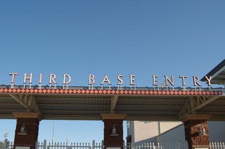 Image of the third base side entrance to a public ball park.