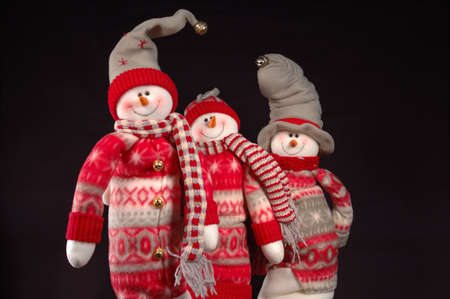 Full shot of three happy snowpeople.