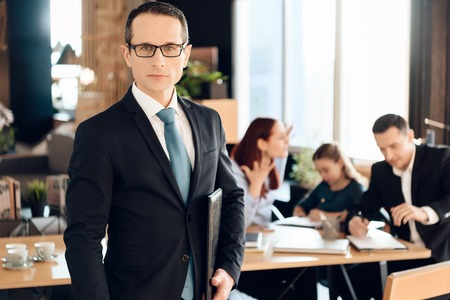 Serious adult man in glasses stands in front of office of family lawyer. Lawyer for family affairs and divorce. Family in office of family lawyer.