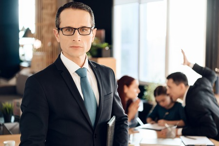 Serious adult man in suit stands in front of office of family lawyer. Lawyer for family affairs and divorce. Family in office of family lawyer. Reklamní fotografie