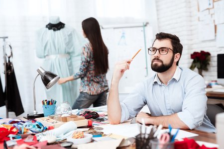 Male fashion designer deep in thought thinking up idea.