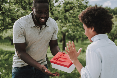 Father Gives Birthday Gift To Son Present Concept Stock Photo