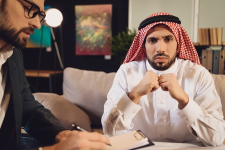 Arabic man at psychotherapist reception in depression. Concept of psychotherapist. Visit to therapist.