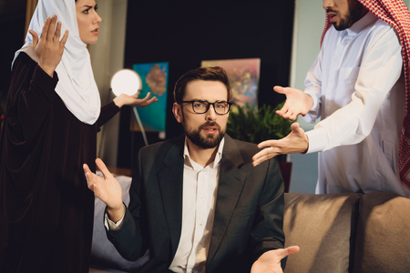Arab couple at therapist reception quarrel. family quarrel. concept of psychotherapist Stock Photo