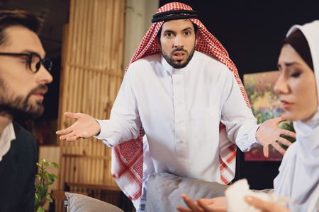 Arabic man confused at psychotherapist reception. Concept of family psychotherapist.
