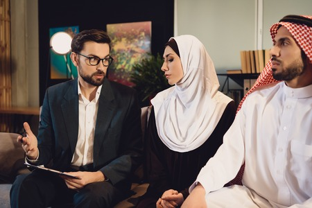 Family therapist in office helps Arab couple. Concept of family psychotherapist. Reklamní fotografie