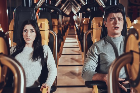 Friends are afraid of carousel. Scary moments of friends in luna park. Frightened expression.