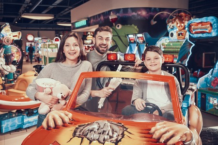 Happy family in amusement park. Family rest, leisure. Spending holiday together with family.