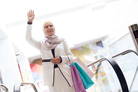 Young Arabian Woman with Packages Standing in Mall
