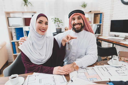 Arabs are smiling while sitting in the office.