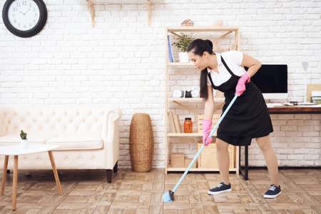 Young girl doing spring cleaning at home.