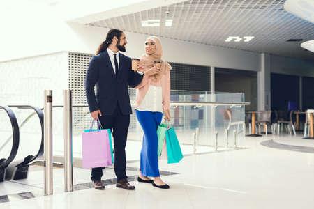 Young Arabian Couple Shopping in Modern Mall.