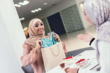 Young Arabian Women Sitting in Cafe in Modern Mall