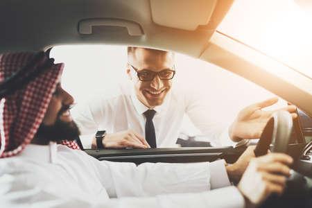 Arab man likes to drive and he smile. Фото со стока