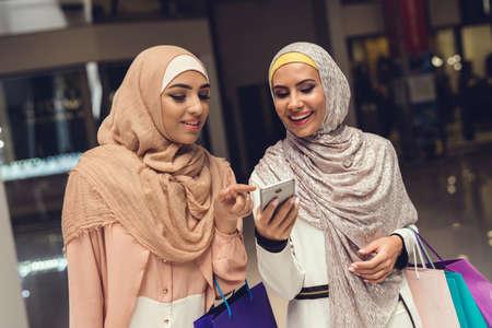 Young Arabian Women Using Smartphone on Shopping.