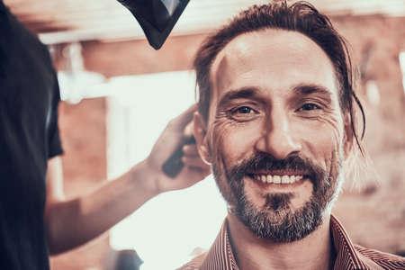 Man looking at the camera while smiling.