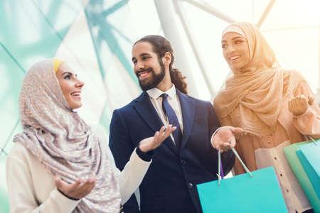Young Arabian People Shopping in Modern Mall.