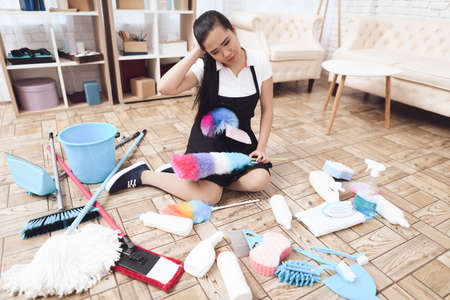Asian woman tired of big house cleaning.