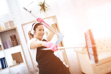 A woman in a special uniform does the cleaning.
