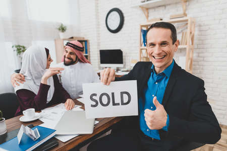 Realtor shows a super gesture and a sign is sold.