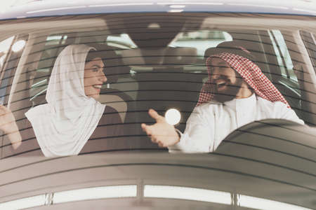 Man and his wife are trying out new car.