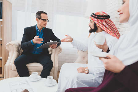 Muslim man discusses something with a realtor.