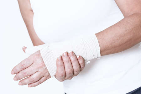 Female hand with rewound hand hold on a sore wrist