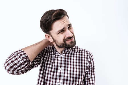 Bearded man stands with neck pain and suffers.