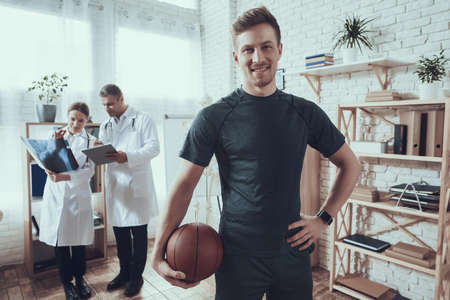 Man basketball player stands in the office.