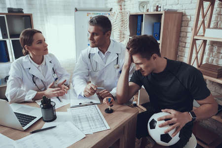 Male and female doctors with stethoscope in office