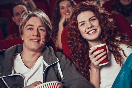 Close-ups of men and women watching a movie. Imagens - 158697874
