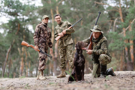 Friends or Family with Gun Dog Hunting in Forest. 写真素材