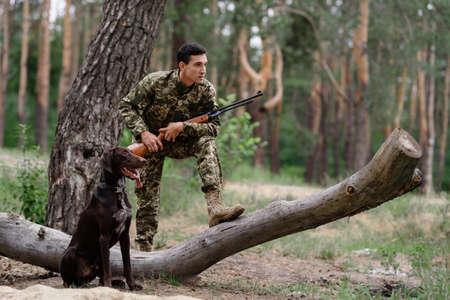 Alert Hunter and Pointer Gun Dog is Near Owner.