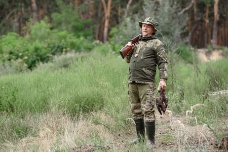 Proud Hunter Holds Wild Duck Happy Senior Man. 写真素材
