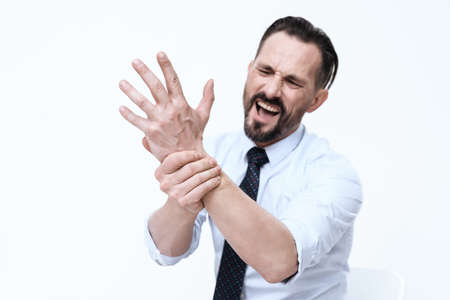 A man with an injured arm screams in pain.